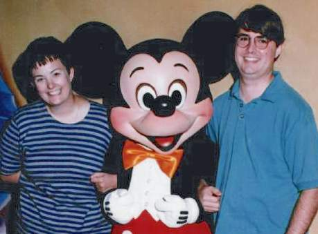 Robin and Paul visiting Mickey in Disneyland